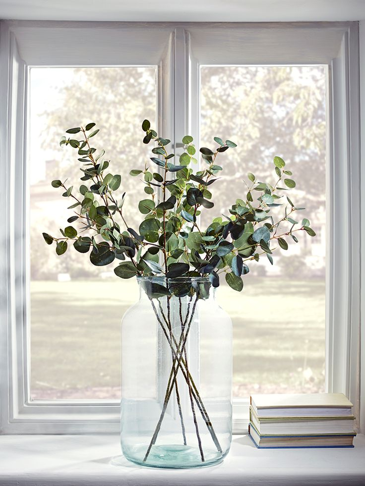 The perfect botanical accent for any living space, our set of six artificial eucalyptus sprays have realistic soft green leaves and long stems, suitable for almost any vase. Perfectly realistic, with petite, glossy leaves, they also pair beautifully with other faux floral stems.