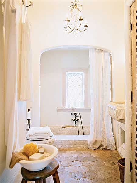 posted on myhomeideas.com from cottage living -- Sunken Tub: An original sunken, tiled tub anchors the bath, and floor tiles salvaged from a European villa accentuate the old-world feel.