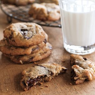 Chocolate Chip Cookies (Williams Sonoma)- Ingredients:  1 cup walnut pieces  2 1/4 cups all-purpose flour  1 tsp. baking soda  1 tsp. kosher salt  1 cup (2 sticks) unsalted butter, at room temperature  2/3 cup granulated sugar  2/3 cup firmly packed light brown sugar  1 whole egg, plus 1 yolk  2 Tbs. light corn syrup, honey or maple syrup  2 tsp. pure vanilla extract  12 oz. semisweet chocolate, chopped into 1/2-inch chunks. Makes about 3 dozen cookies.