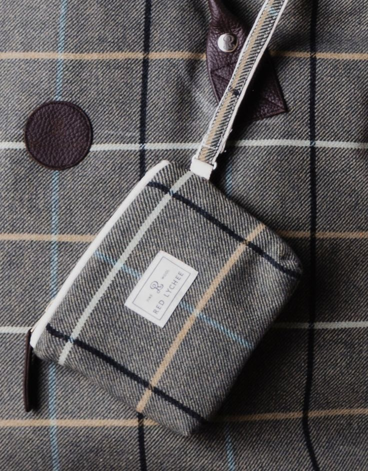 Red Lychee Foxwood Wool wallet/pouch designed in a long format made from finest wool and finished with ecru trim.