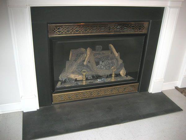 Black slate fireplace surround.