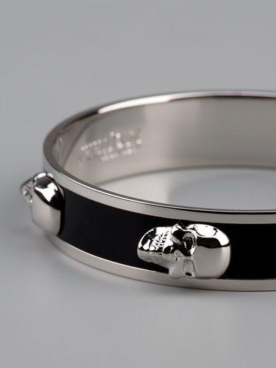 Alexander McQueen silver 'skull' bracelet with contrasting black enamel.