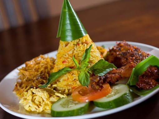 INDONESIAN FOOD - Nasi Kuning (Yellow Rice)  Serve with vegetables only if you are vegan or vegetarian