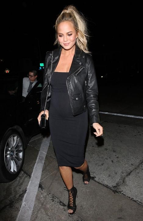 We're still loving Chrissy Teigen's sexy maternity style. Click to see her latest outfit (it looks SO MUCH like something Kim Kardashian wore when she was pregnant)