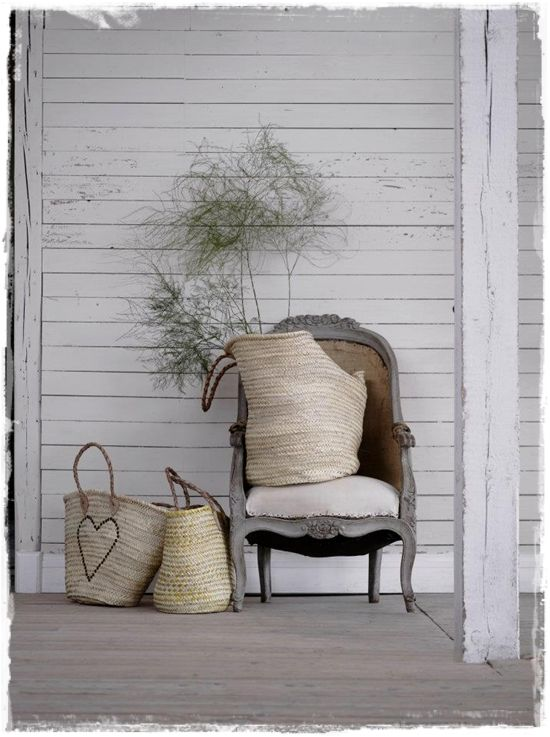 french baskets and I LOVE that chair.. oh, and the white wood too.