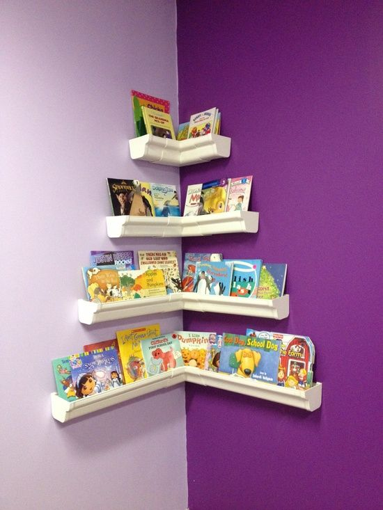 Whether you are designing a new nursery or carving out a quiet space for your toddler's story time, rain gutter shelving is ideal for over-sized books. Be sure to mount gutters securely to the wall and at a height that your kids can reach easily.
