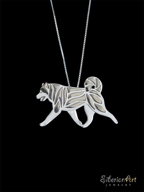 An unique Alaskan Malamute movement pendant & necklace, designed by Amit Eshel.  This delicate fine jewelry will keep your best buddy close to