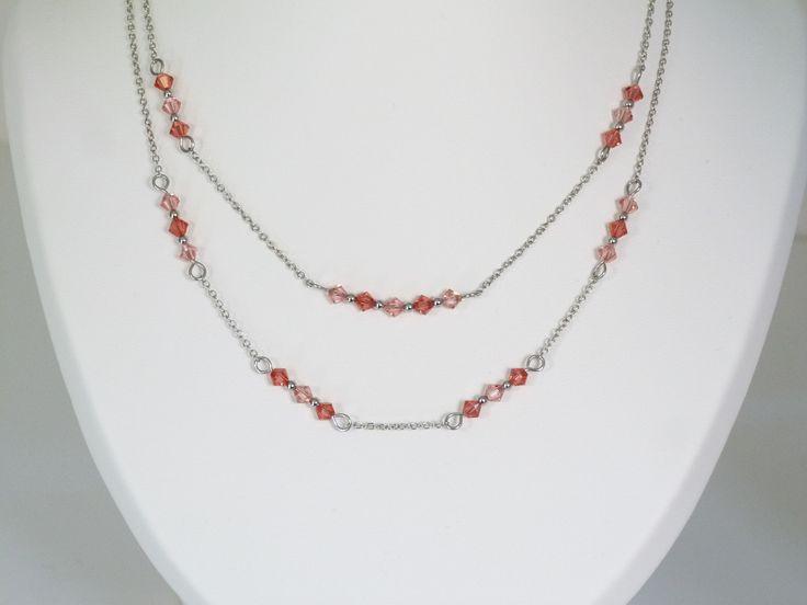 Ras du cou double rang corail et corail clair composé de toupies en cristal Swarovski : Collier par oana-bruz