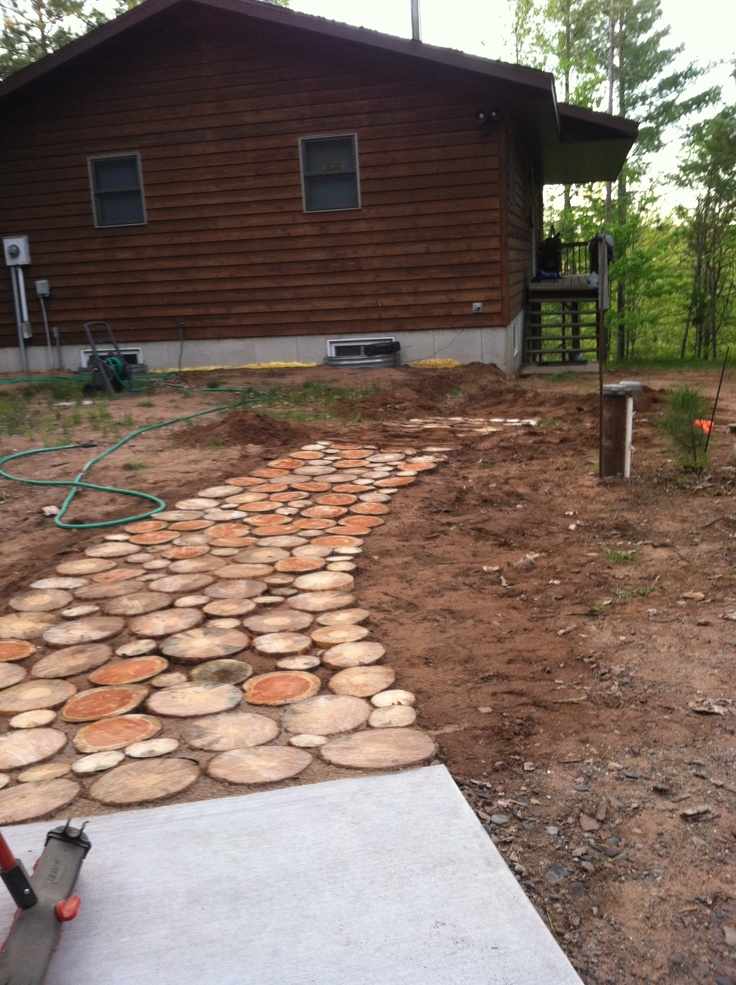 This is walkway created from using tree trunk slices for