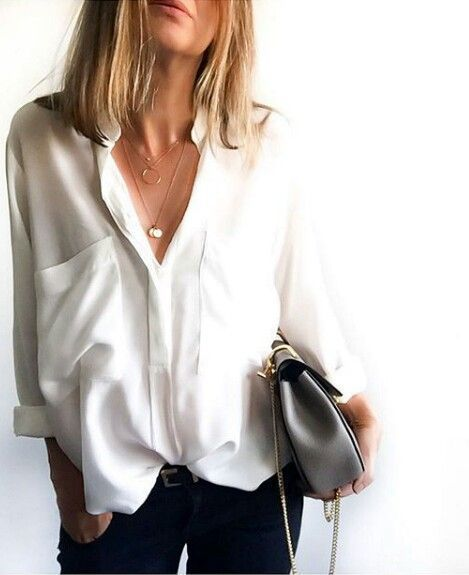 loose white collared blouse, good look for business casual