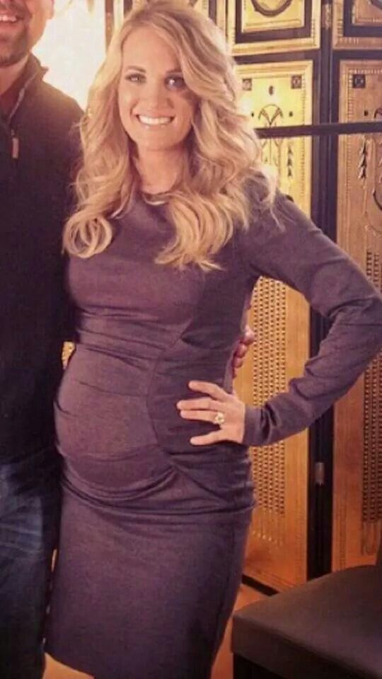 Beautiful pregnant Carrie Underwood in Purple