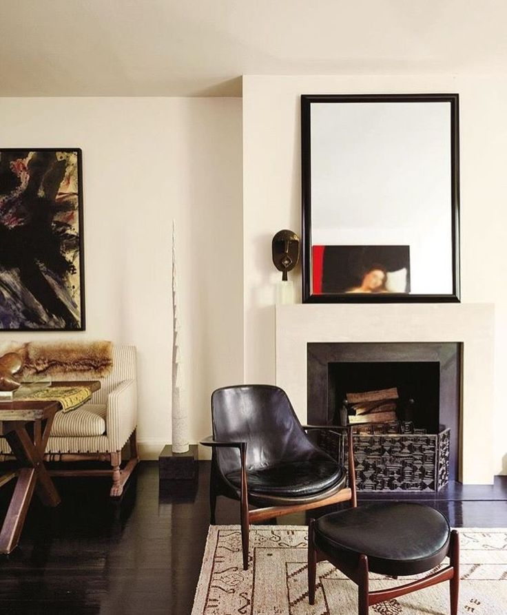 A Danish Modern Armchair And Ottoman From Wyeth Rest In Front Of The  Fireplace, Which Is Surmounted By A Tommi Parzinger Mirror From Pascal Boyer  Gallery.