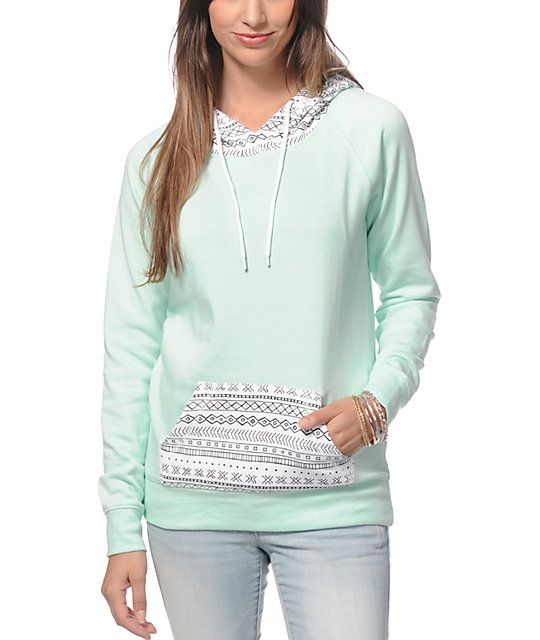 A crisp mint body is contrasted by a tribal print hood and pocket for a trendy look, while the long and slim fit makes this pullover hoodie perfect for layering.