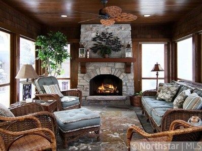 pictures+of+sunrooms+with+fire+place | season porch/sunroom rustic fireplace and ceiling | New House Ideas
