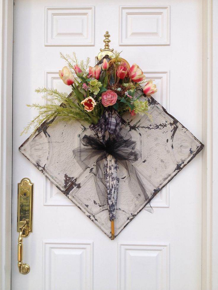 Vintage toile umbrella filled with spring flowers, mounted on an antique tin ceiling tile