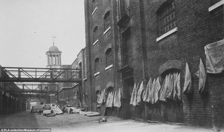 Sugar sacks are pictured at the rear of a building in this undated photo from when an era when West India Quay was a thriving area for importation