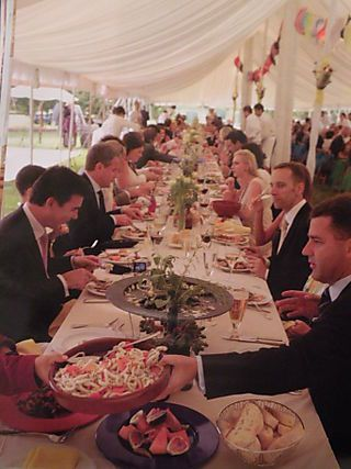 Family Style Dinner - guests serve themselves and each other like a big family dinner.  Still have a buffet for dessert and drinks? Or have pitchers of lemonade, water, juice, along with wine at the table...