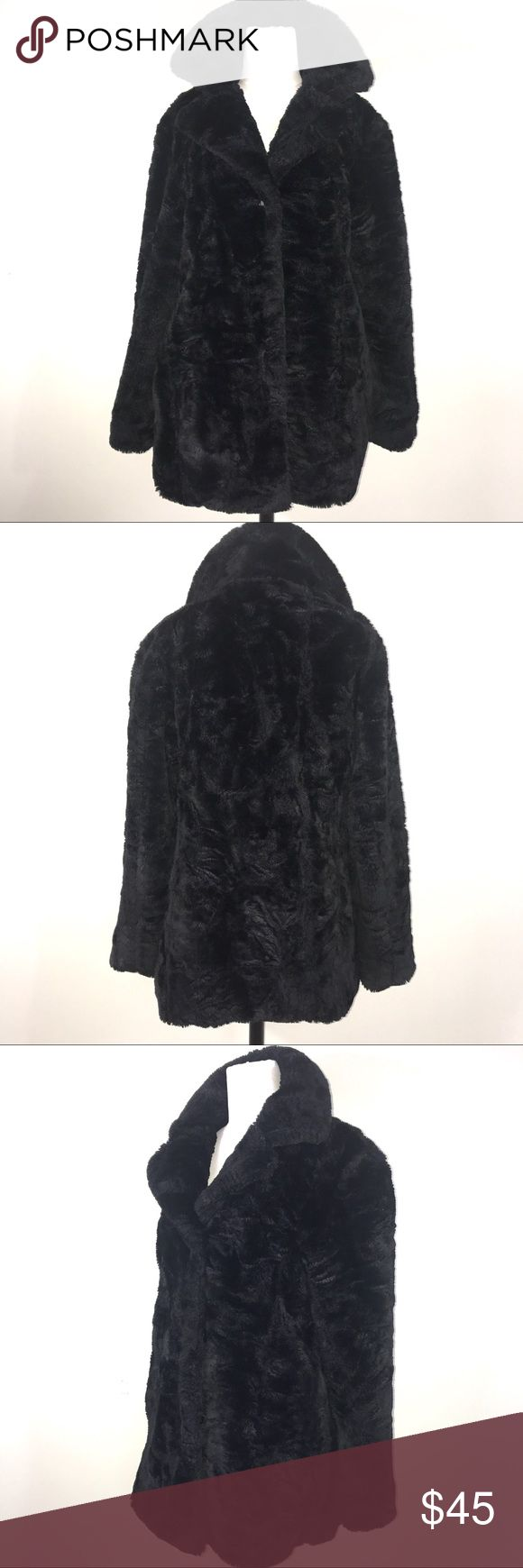 """United Colors of Benetton Faux Fur Coat Size Small This United Colors of Benetton Faux fur coat is in beautiful condition. It is a heavy black fabric and lined. It is a size small and vintage in age, as you can see from the tag. Green tag has come undone on one side. Has 3 buttons and 2 hand pockets on the sides. Length is approximately 29"""", bust 21"""". United Colors Of Benetton Jackets & Coats Pea Coats"""