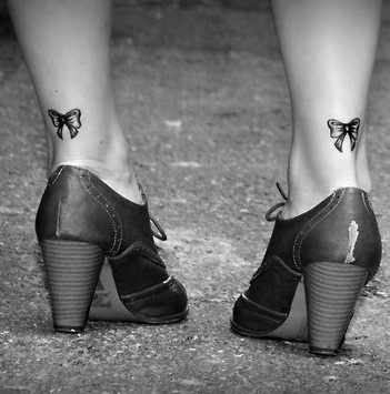 I love bow tattoo's! These look almost identical to the ones I have, the only difference is that mine are a little bigger and the ribbons flare out.