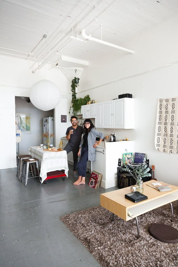 A creative couple make a sunny, bright and minimal home and workspace in a one-room East Bay California loft apartment.