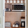 Cabinet to hide modern appliances - toaster, microwave, coffee maker - giving the kitchen a vintage feel, and keeping the countertops uncluttered.