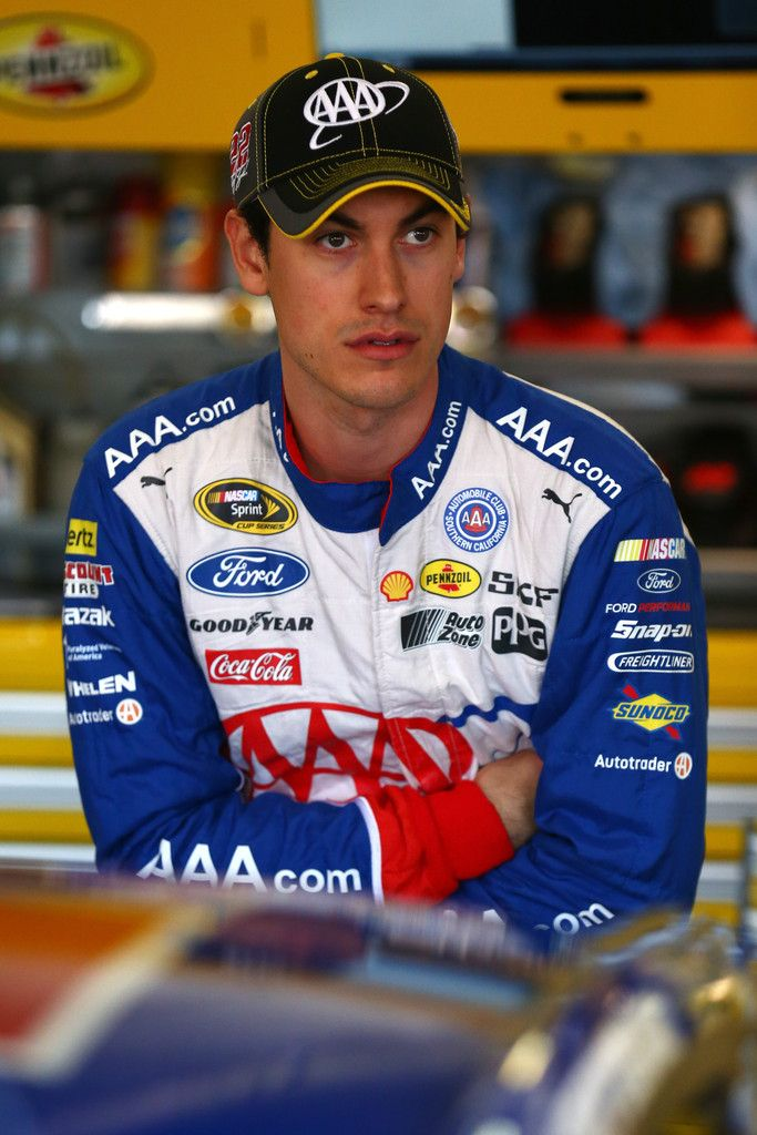 Joey Logano, driver of the 22 AAA Insurance Ford, stands