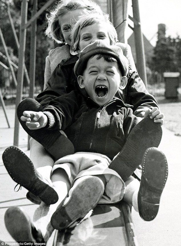Young and free: Children playing in 1950s Britain when 'no one seemed to be as frightened as they are now'.