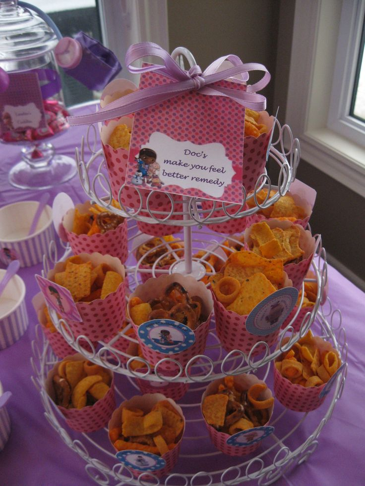 "Doc McStuffins birthday party table decor.  Doc's ""make you feel better"" remedy - party mix."