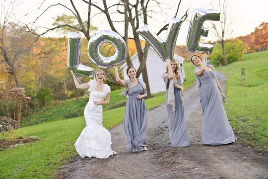 bridesmaids help spread the L O V E with metallic silver balloons in this rustic glam wedding | casey connell photography & By Emily B events