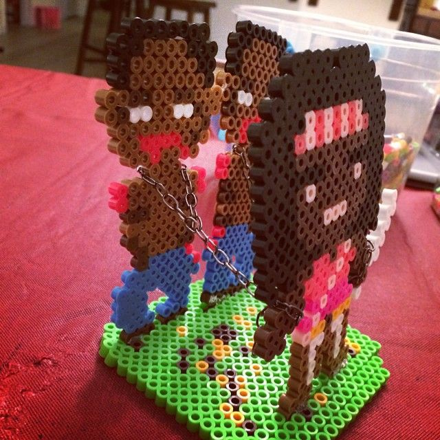 Michonne and her zombies made out of Perler Beads : thewalkingdead