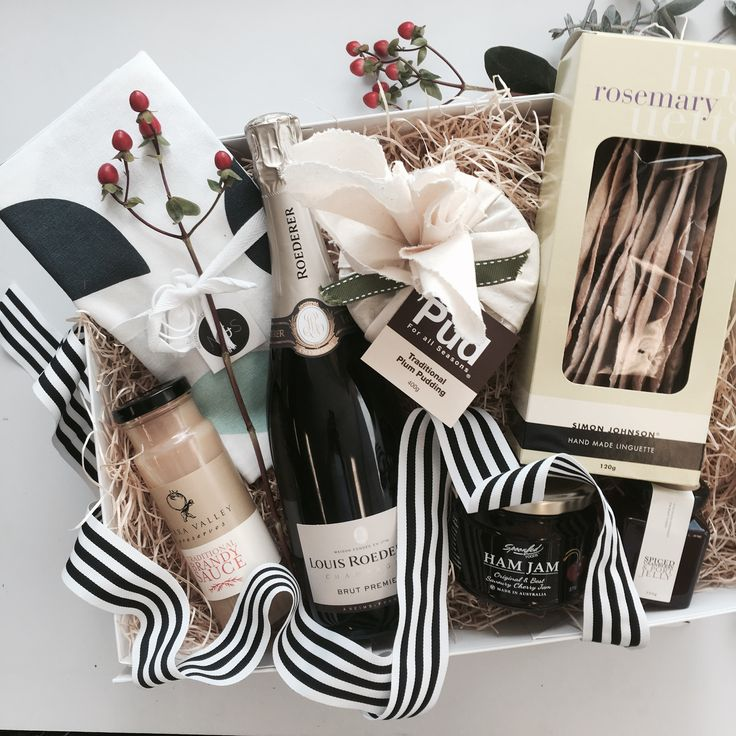 Christmas Gifts and Hamper ideas.  Make someone's Christmas extra special with this amazing gifts filed with cheer. It includes:  - Louis Roederer Brut Premier  - Simon Johnson Rosemary Linguette flat bread  - Spoonfed Ham Jam  - Pud for All Seasons Traditional Pudding 400gm  - Yarra Valley Gourmet Foods Traditional Brandy Sauce  - Yarra Valley Gourmet Food Spiced Cranberry & Port Jelly  Packaged in an exclusive Gifting Co box with black & white stripped grosgrain ribbon & swing tag.
