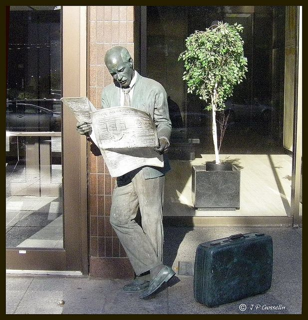 """Statue titled ''Catching Up'' 