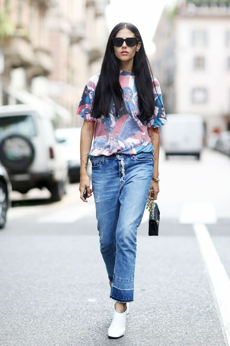 Chiara Totire went casual in boyfriend jeans and a printed tee...Milan #MMFW