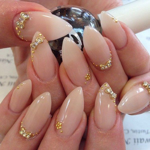 Simplicity is beauty as they always say. This is because the simpler you go, the more your true beauty shines. These nails truly speak for themselves. They do not need so much color, simply a plain nude polish and a couple of elegant gold acrylic and silver beads are enough to do the job.