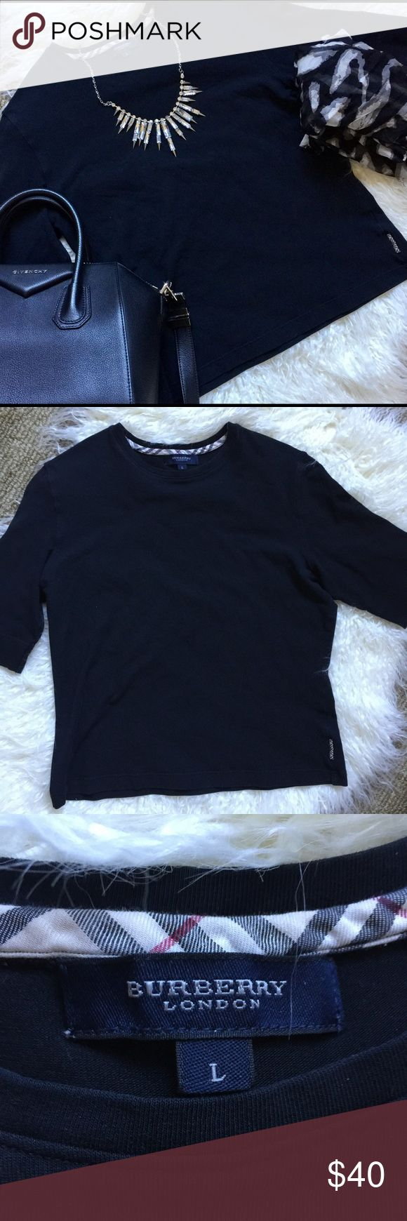 Burberry black knit top  Black Burberry London top.  Size large.  Super soft, Burberry pattern in the back of the beck and on left bottom side  - see photos. Great staple piece.   Material tag removed but it feels like a cotton with stretch material. Burberry Tops Tees - Short Sleeve