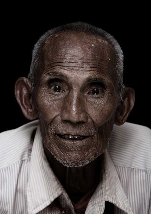 """""""Diaspora Smile"""" is a part of an ongoing photographic project that captures the joy of elderly Tibetan refugees who lived in exile for more than fifty years. I regularly took their portraits on the night after they have received private blessing from His Holiness Dalai Lama."""