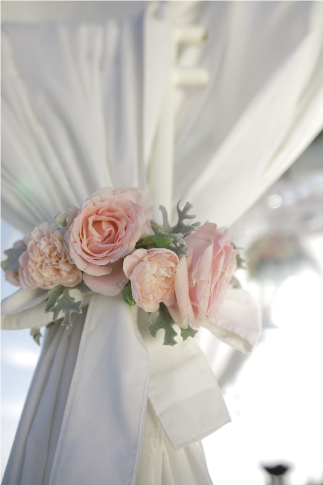 The drapes tied with Pink Rose & Carnation a by Tirtha Bridal Uluwatu Bali