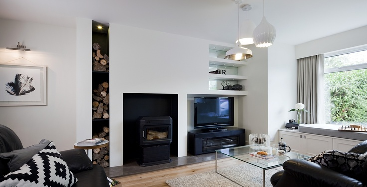 Feature architectural fireplace wall with painted steel alcoves and mink limestone hearth. Bespoke window seat with built in wine storage. Designed by Kingston Lafferty Design