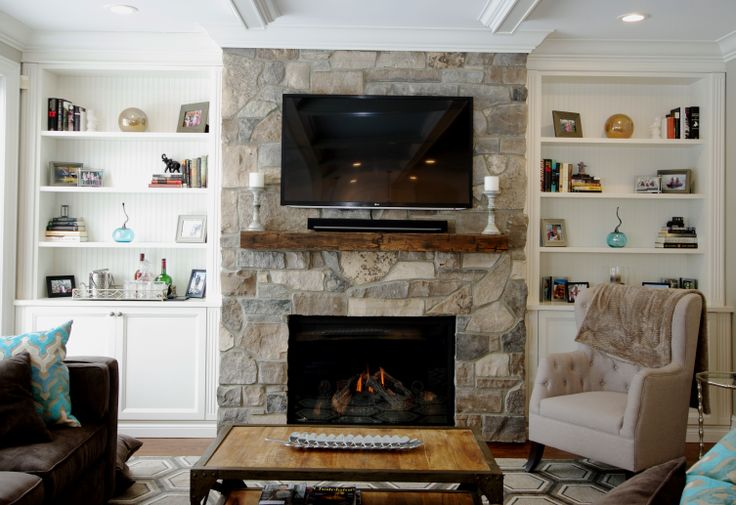Stunning built ins! Stone fireplace and wood mantle