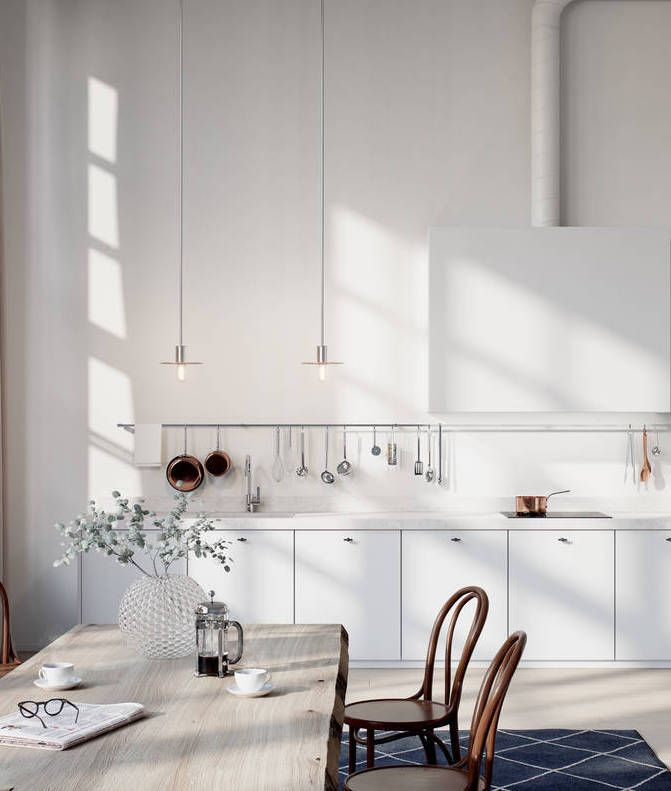 Simple white minimal kitchen with warm wood accessories