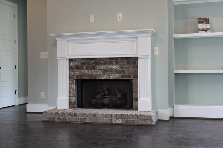 Half brick fireplace surround with raised hearth for Fireplace half stone