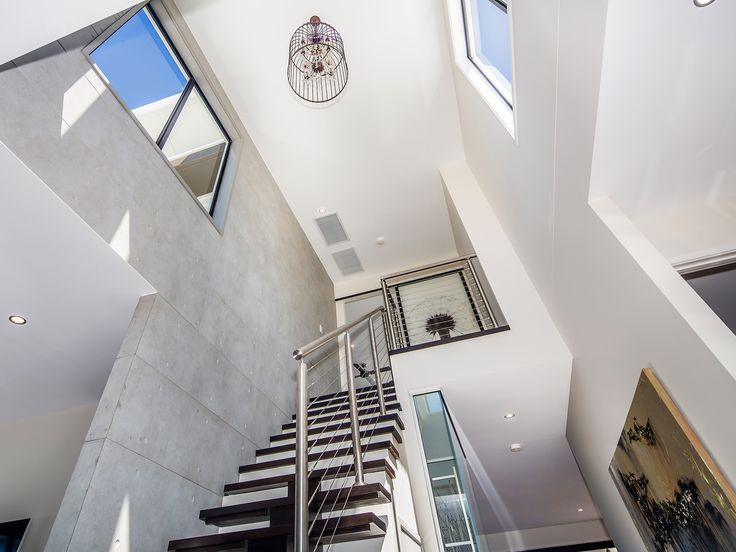 Villa on the Green - Staircase to main suite - 2306 Vardon Lane, Sanctuary Cove, Queensland. Luxury holiday home for exclusive escapes. #holidays #luxuryhomes #holidayhomes #queenslandholiday #luxuryescapes #getaway