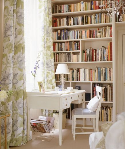 Room with desk and long floral curtains