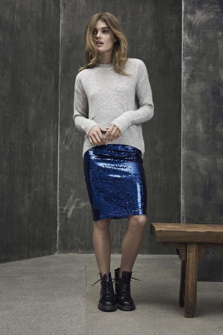 Grey knit and a cool sparkling blue skirt.