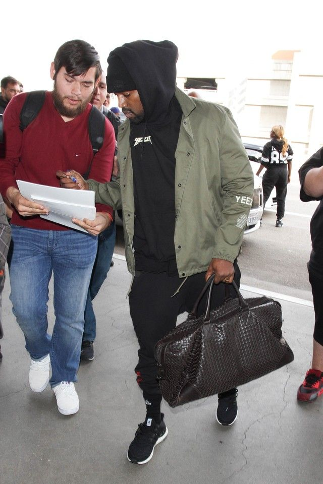 Kanye West wearing Bottega Veneta Nero Intrecciato VN Large Duffel, Yeezy Season 3 Invitation Jacket, Gosha Rubchinskiy x Dover Street Market Sweatpants, Adidas Ultra Boost Shoes, Adidas Traxion Premier Crew Socks Large 1 Pair