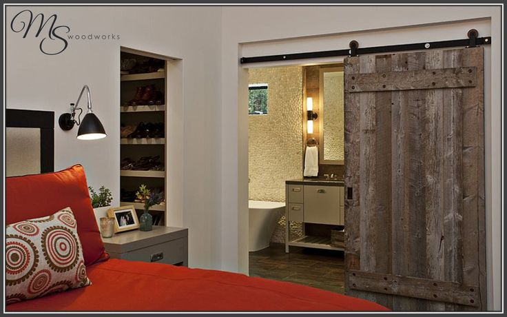 Old barn doors can add a cozy, yet rustic vibe to your room. For a custom quote on a sliding door like this one, contact MSWoodworks TODAY!