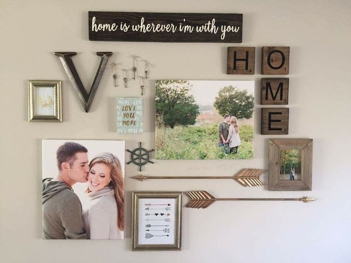 DIY gallery wall inspiration and idea.  coastal theme with arrows, canvas and photos.   Loves the Find