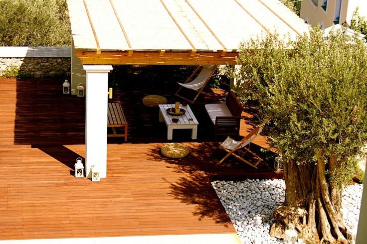 Xenon Estate villas in Spetses - swimming pool deck with a kiosk under a pergola.  www.xenonestate.gr