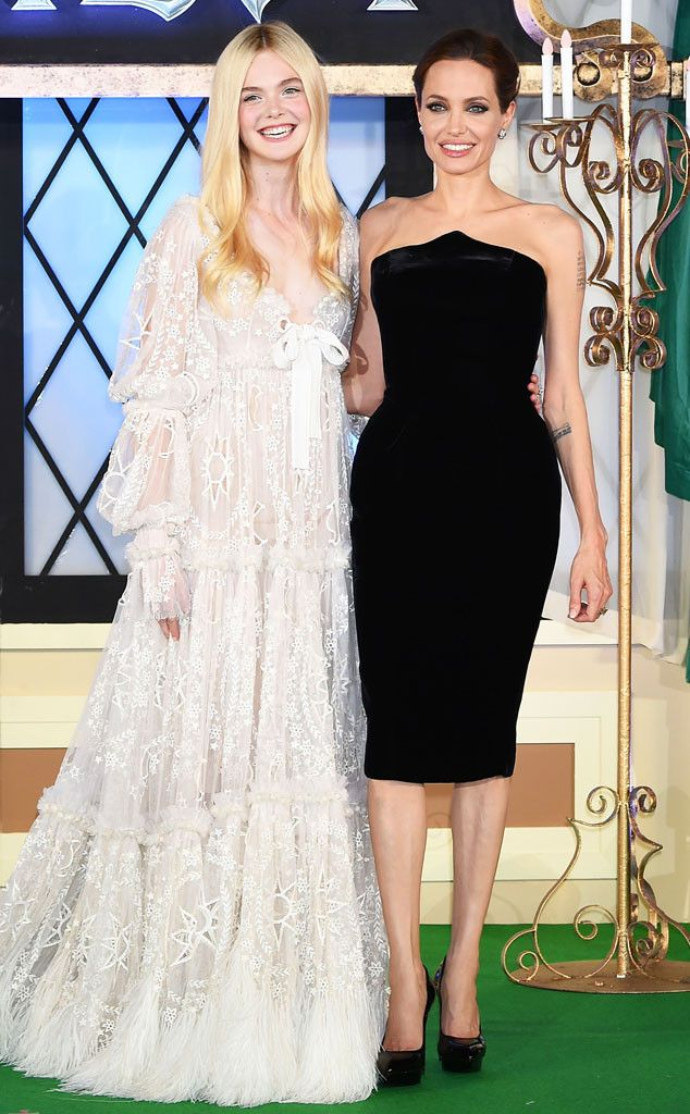 Maleficent costars Elle Fanning and Angelina Jolie bring their flawless fashion to Tokyo!