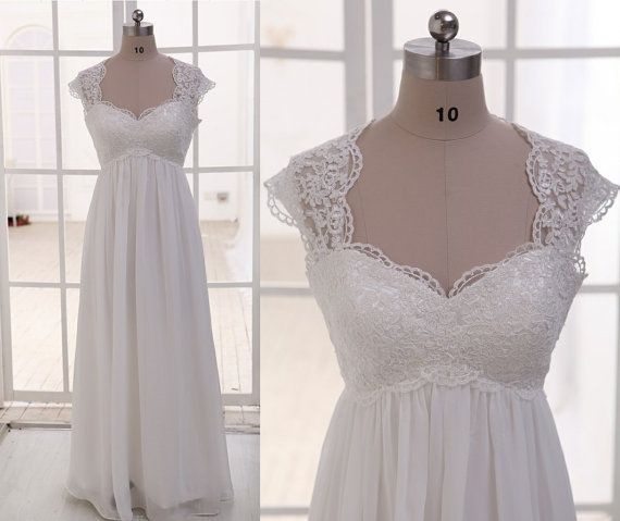 Absolutely perfect   https://www.etsy.com/listing/155799092/lace-chiffon-wedding-dress-cap-sleeves